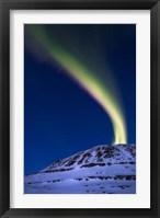 Framed aurora borealis shooting up from Toviktinden Mountain, Norway
