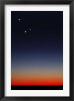 Framed Venus, Mercury and Mars above the glowing horizon at dawn