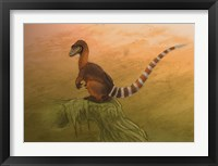 Framed Sinosauropteryx dinosaur resting on a log
