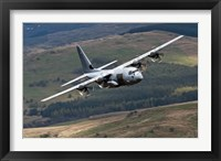 Framed C-130 Hercules of the Royal Air Force flying over North Wales