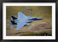 Framed F-15E Strike Eagle low flying over North Wales