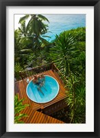 Framed Couple enjoying hot tub at Fregate Resort, Seychelles