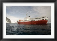 Framed Expedition ship and zodiac, Pleneau Island, Antarctica
