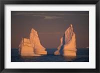 Framed Antarctic Peninsula, icebergs at midnight sunset.