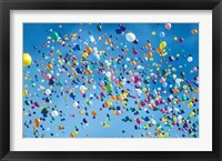 Framed Holiday balloons drifting into the sky