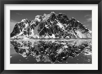 Framed Antarctica, Mountain peaks reflected in the Lemaire Channel.