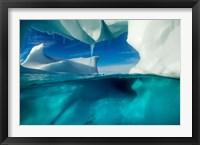 Framed Antarctica, Arched Iceberg floating near Enterprise Island.