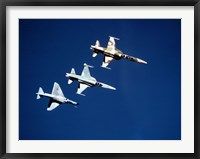Framed Two F-5 Tiger II's and an A-4E Skyhawk in flight above the Pacific Ocean