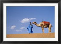 Framed Man leading camel on sand dunes, Tinfou (near Zagora), Morocco, Africa