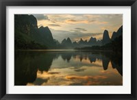 Framed Li River and karst peaks at sunrise, Guilin, China