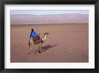 Framed Man in Traditional Dress Riding Camel, Morocco
