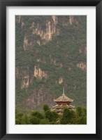 Framed Pagoda and giant karst peak behind, Yangshuo Bridge, China