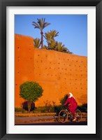 Framed Veiled Woman Bicycling Below Red City Walls, Marrakech, Morocco