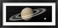 Framed Large planet Saturn and its rings next to small planet Earth