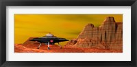 Framed UFO landing on a desert landscape