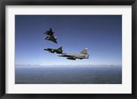 Framed Four Saab 37 Viggen fighters breaking up over northern Sweden