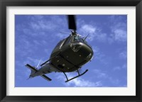 Framed Former US Air Force Bell UH-1E Huey helicopter in flight