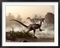 Framed pair of velociraptors patrol the shore of an ancient lake