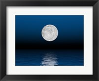 Framed Beautiful full moon against a deep blue sky over the ocean