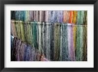 Framed China, Suzhou. Hanging silk threads, market