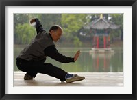 Framed Man Doing Tai Chi Exercises at Black Dragon Pool with One-Cent Pavilion, Lijiang, Yunnan Province, China