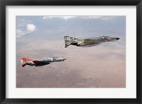 Framed Two QF-4E Phantom II drones in formation over the New Mexico desert