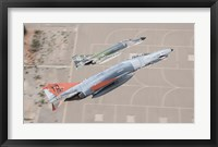 Framed Two QF-4E Phantom II drones break over Holloman Air Force Base, New Mexico