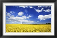 Framed Wind turbine in a canola field against cloudy sky, Denmark