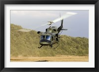 Framed Italian Air Force AB-212 ICO helicopter departs the landing zone, Italy