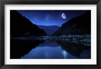 Framed Moon rising over tranquil lake and forest against starry sky, Bulgaria