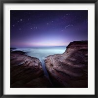 Framed Two large rocks in a sea, against starry sky