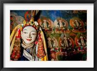 Framed Religious statue infront of Buddha mural at Shey Palace, Ladakh, India