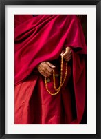 Framed Hands of a monk in red holding prayer beads, Leh, Ladakh, India
