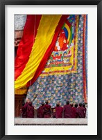 Framed Monks raising a thangka during the Hemis Festival, Ledakh, India