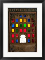 Framed Brightly colored glass window, City Palace, Udaipur, Rajasthan, India.