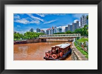 Framed Singapore skyline and tug boats on river.