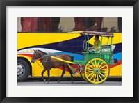 Framed Horse cart walk by colorfully painted bus, Manila, Philippines