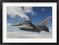 Framed F-16 Fighting Falcon flies with AGM-65 Maverick