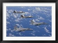 Framed F-15 Eagles and F-22 Raptors Fly in Formation