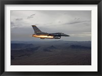 Framed F-16 Fighting Falcon Fires an AGM-65 Maverick Missile
