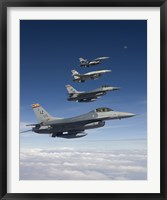Framed Four F-16's Fly in Formation During a Training Mission