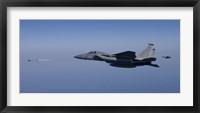 Framed F-15 Eagle Fires an AIM-9 Missile