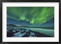 Framed Aurora Borealis over the Ice Beach near Jokulsarlon, Iceland