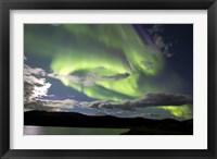 Framed Aurora borealis over Fish Lake, Yukon, Canada