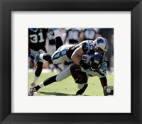 Framed Luke Kuechly with the ball 2014