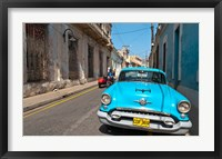 Framed Cuba, Camaquey, Oldsmobile car and buildings