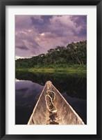 Framed Paddling a dugout canoe on Lake Anangucocha, Yasuni National Park, Amazon basin, Ecuador