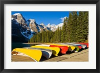 Framed Moraine Lake and rental canoes stacked, Banff National Park, Alberta, Canada