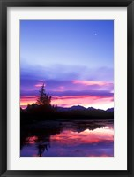 Framed Crescent Moon Over Vermillion Lake in Banff National Park, Alberta, Canada