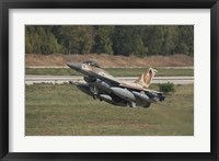 Framed F-16C Barak of the Israeli Air Force taking off from Hatzor Air Force Base